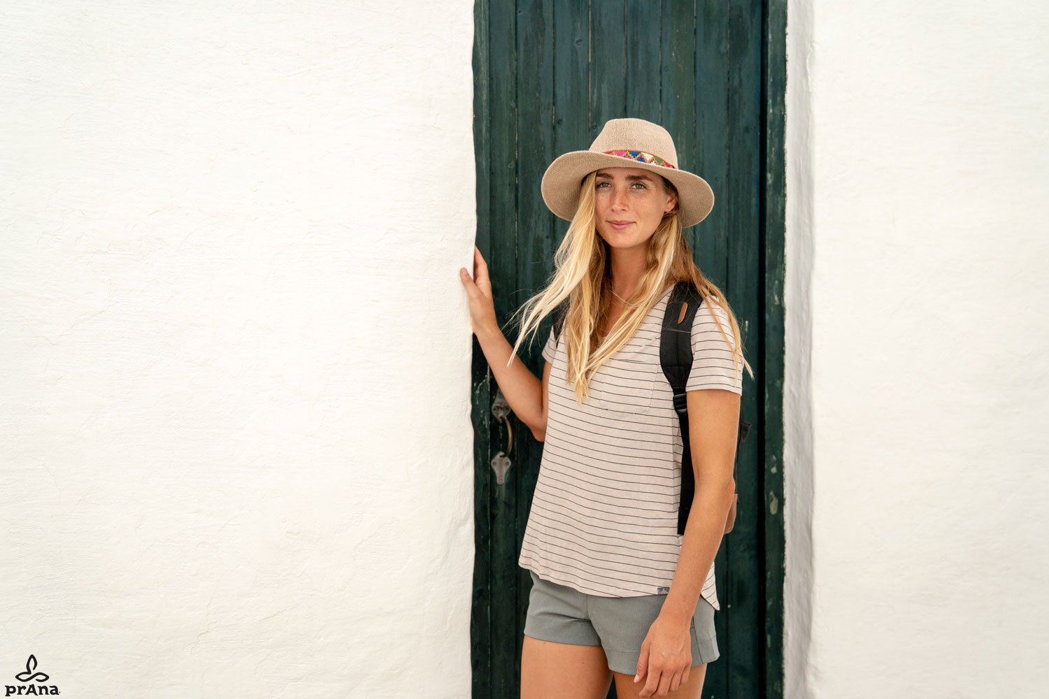 Girl in vacation clothes hat, t-shirt, backpack, shorts exploring traveling